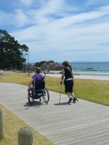 Guests making use of the wonderful accessible beach boardwalk in Mount Maunganui New Zealand